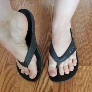 Crocs chocolate brown flip flops